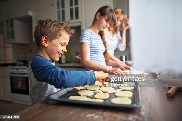 Family having fun baking cookies