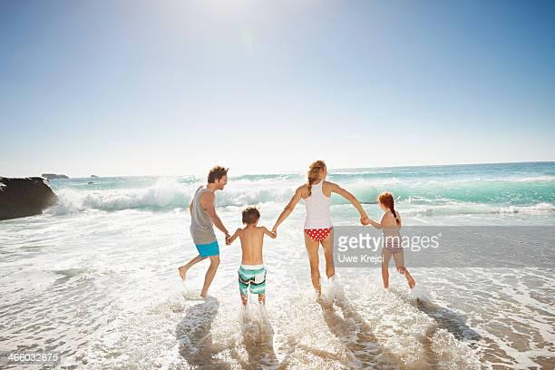 Family having fun by the ocean