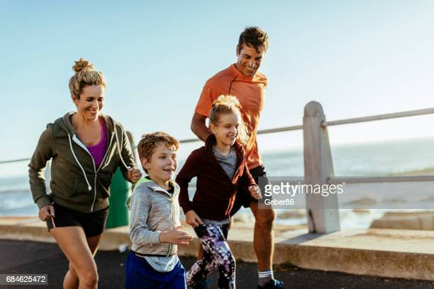 family having fun doing sports - sportswear stock pictures, royalty-free photos & images