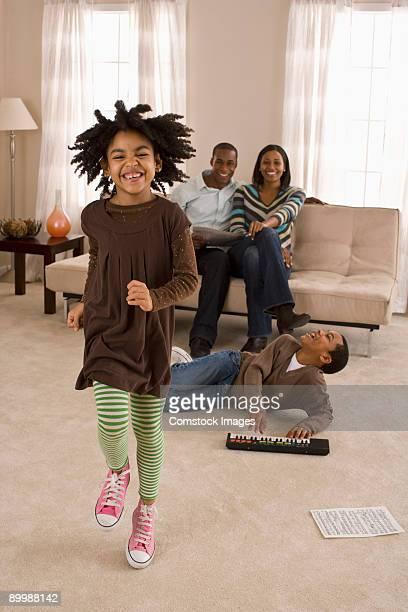 family having fun in livingroom