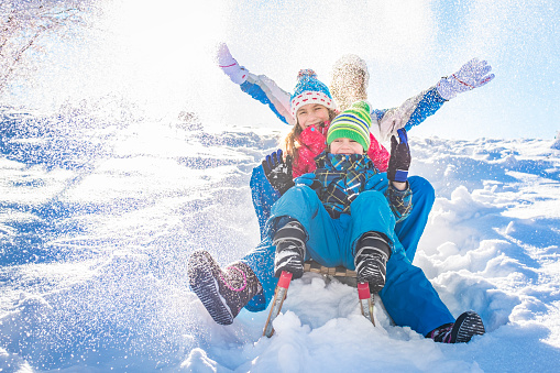 Family having fun in winter 615514226