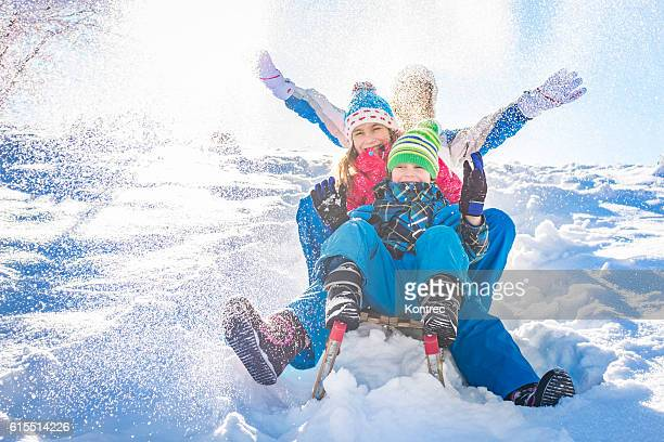 family having fun in winter - winter sport stock pictures, royalty-free photos & images