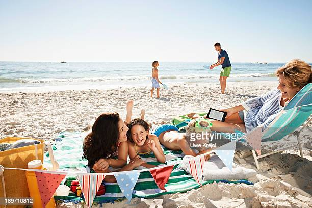 family having fun on beach - beach holiday stock pictures, royalty-free photos & images