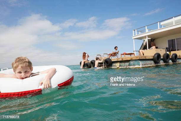 family having fun on houseboat sun deck, kraalbaai, south africa - sea swimming stock photos and pictures