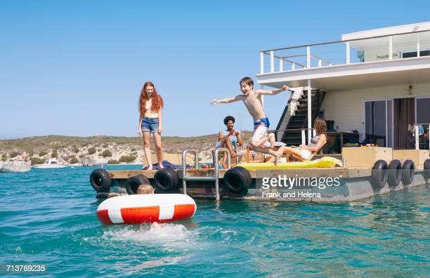 family having fun on houseboat sun deck, kraalbaai, south africa - houseboat stock pictures, royalty-free photos & images