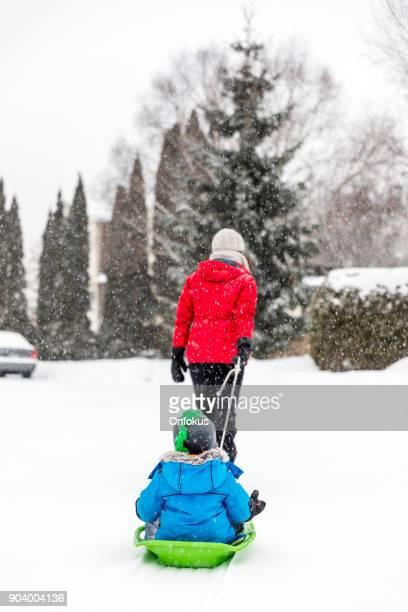Family having fun Outdoor in winter