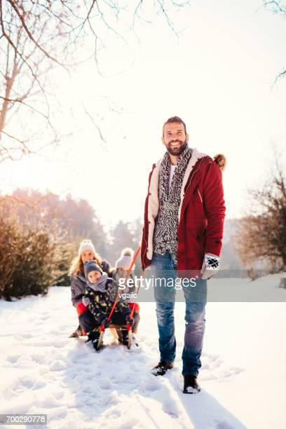 Family Having Fun Outdoors At Winter