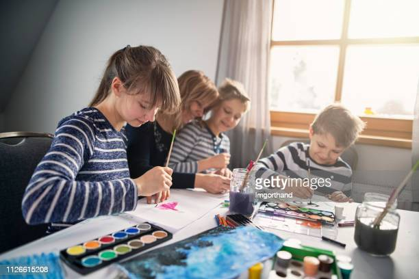 family having fun painting at home - art and craft stock pictures, royalty-free photos & images