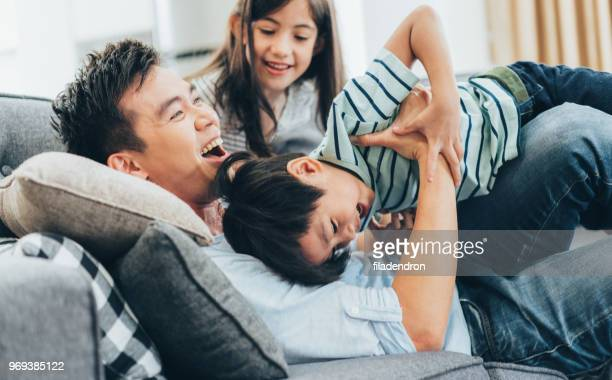 family having fun - asian and indian ethnicities stock pictures, royalty-free photos & images