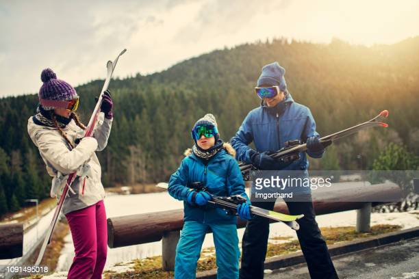 family having fun playing with skis - slovakia stock pictures, royalty-free photos & images