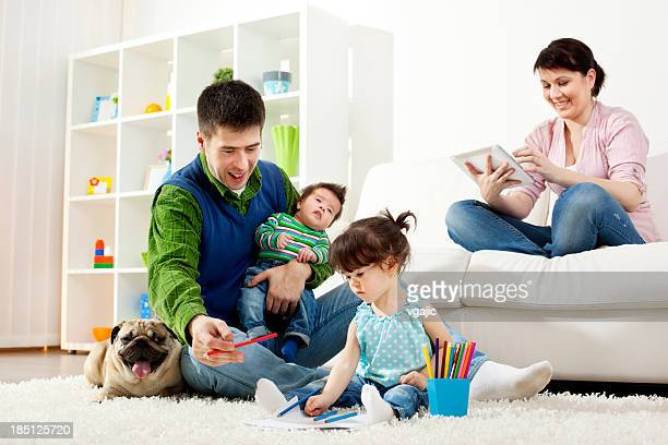 family having fun together at home - colouring book stock pictures, royalty-free photos & images