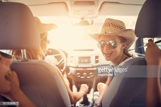 family having fun travelling by car - car interior stock pictures, royalty-free photos & images