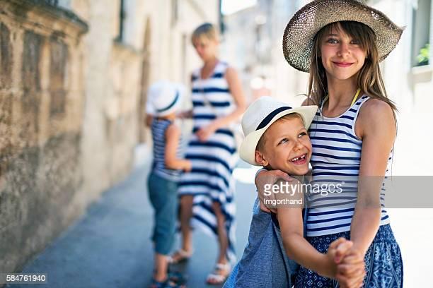 Family having fun visiting the beautiful Majorcan town of Pollenca