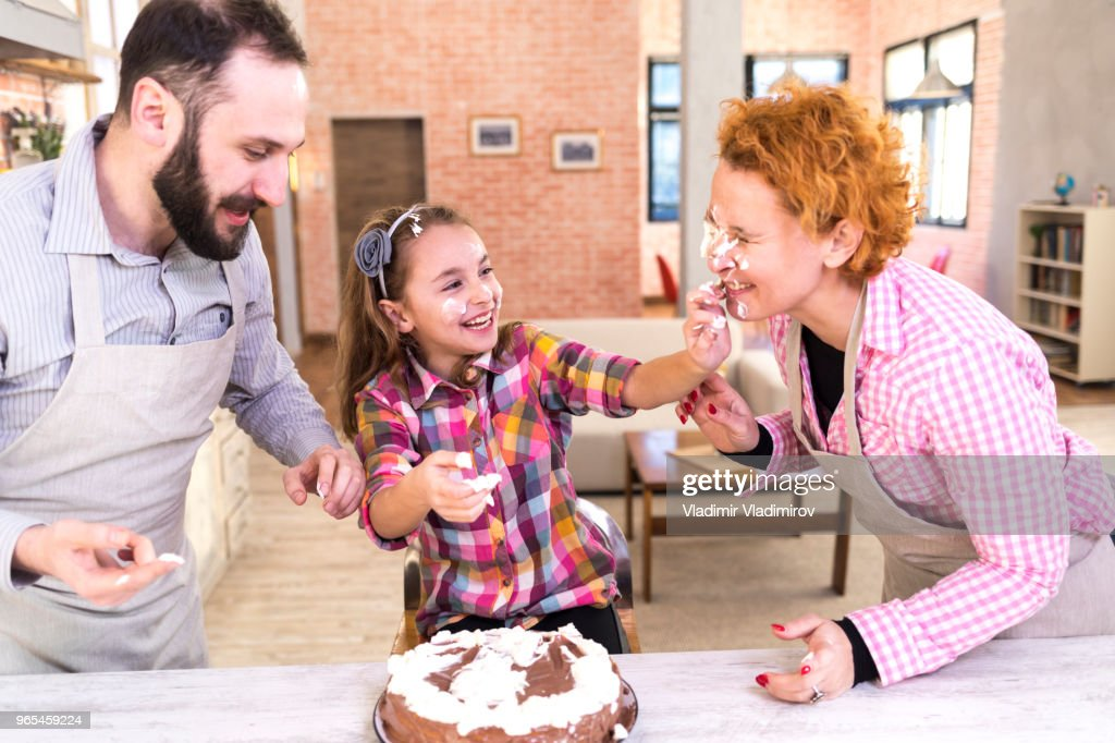 Wondrous Family Having Fun With Birthday Cake High Res Stock Photo Getty Funny Birthday Cards Online Bapapcheapnameinfo