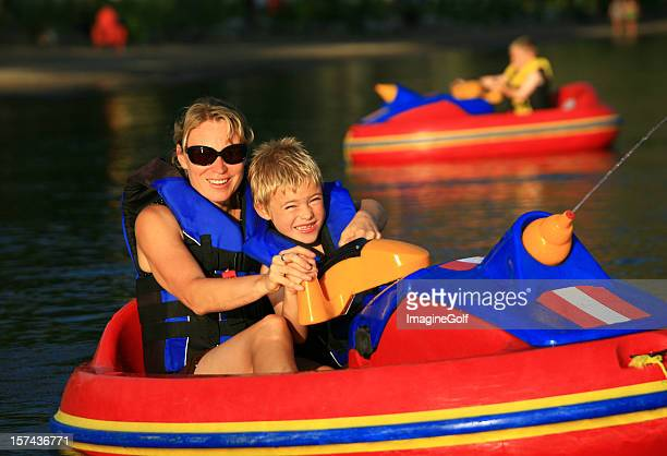 family having fun with bumper boats - bumper stock pictures, royalty-free photos & images