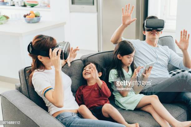 Family having fun with VR simulator