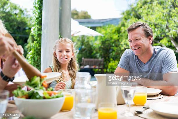 Family having healthy breakfast at outdoor table