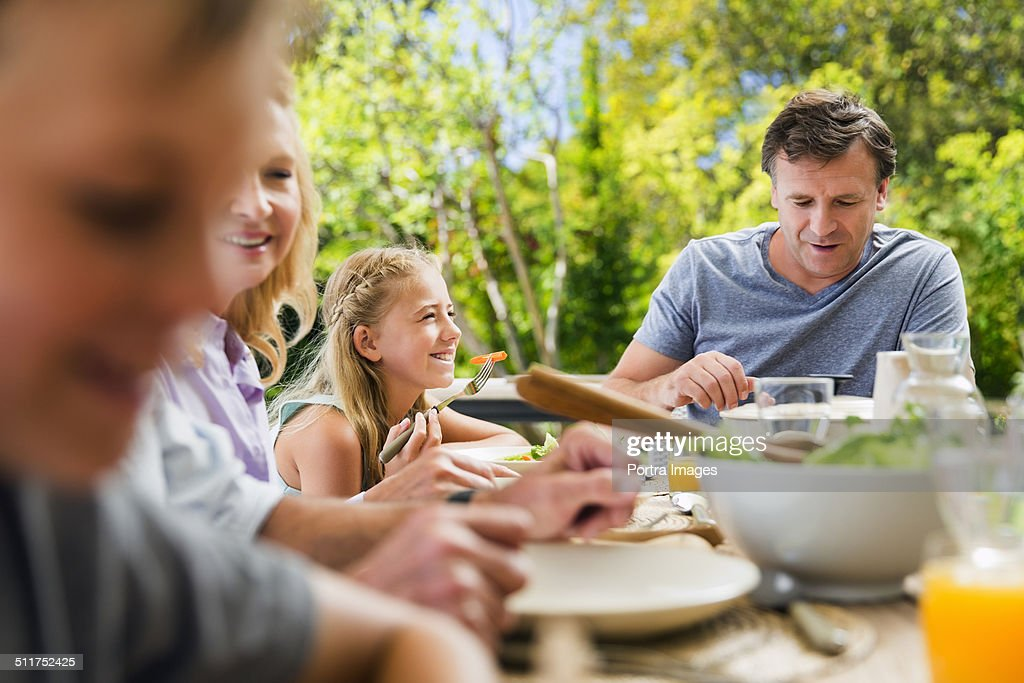 Family having healthy breakfast at table : Stock Photo