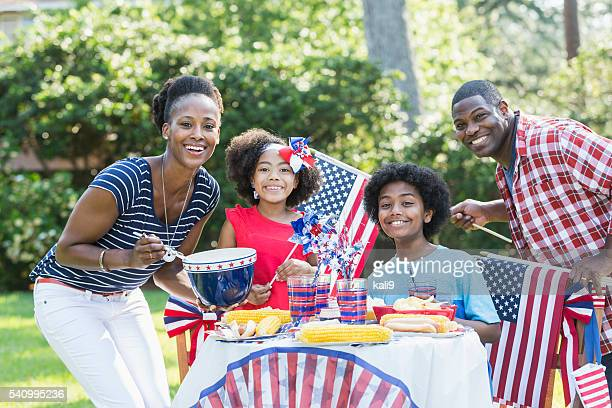 Family having July 4th or Memorial Day picnic
