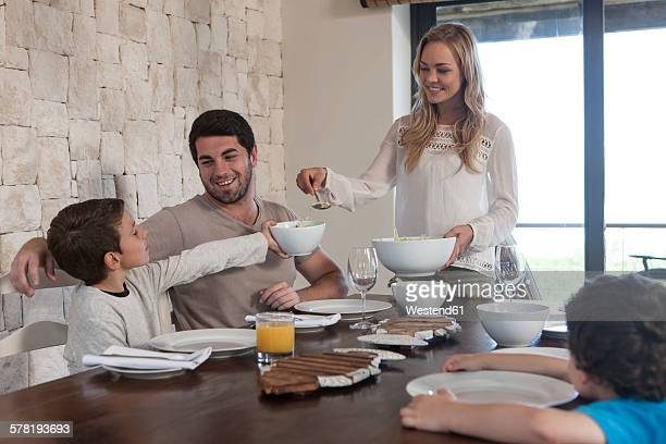 Family having lunch at dining room table