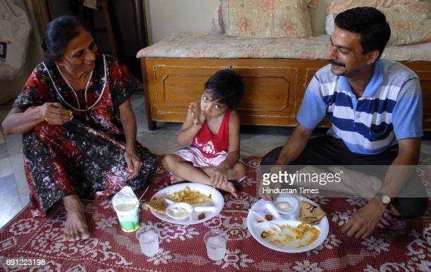 A family having lunch at home using disposable utensils at Girgaum while the area faces a 100% watercut due to the work which began on replacing the...