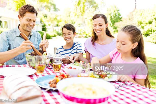 Family Having Lunch At Outdoors