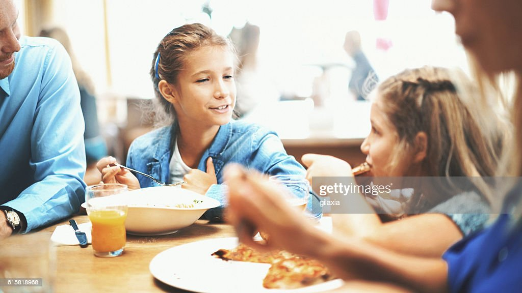 Family having lunch in a restaurant. : Stock Photo