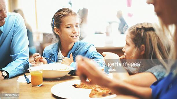 Family having lunch in a restaurant.