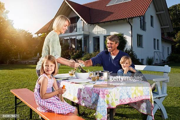 Family having lunch in garden