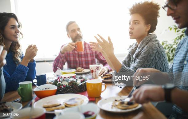 family having lunch. - dining table stock pictures, royalty-free photos & images