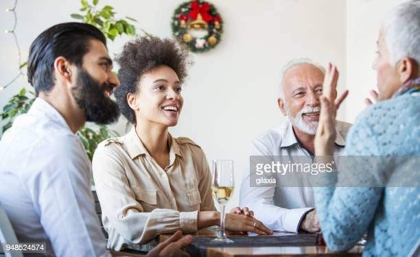 family having lunch. - mother in law stock pictures, royalty-free photos & images