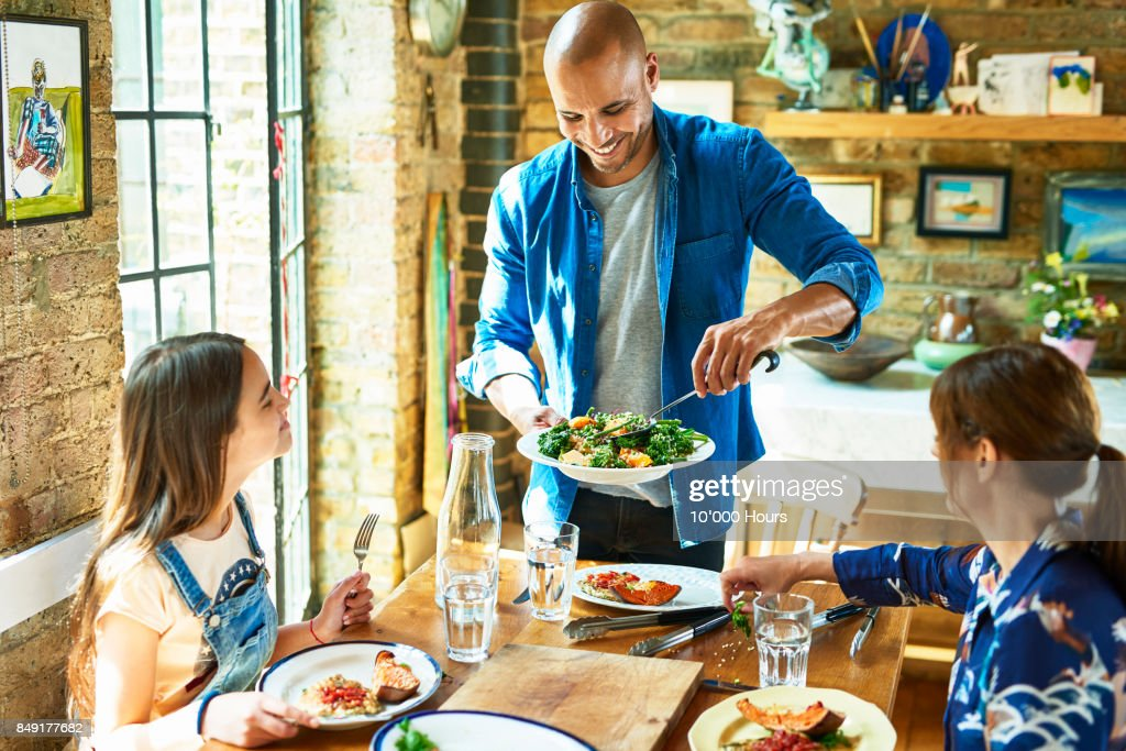 Family having lunch togehter : Stock Photo