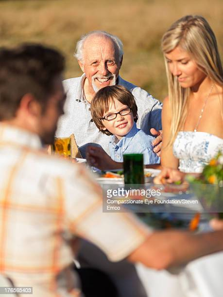 Family having lunch together outdoors