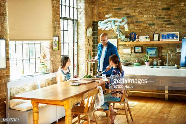 family having lunch together - gourmet küche stock-fotos und bilder