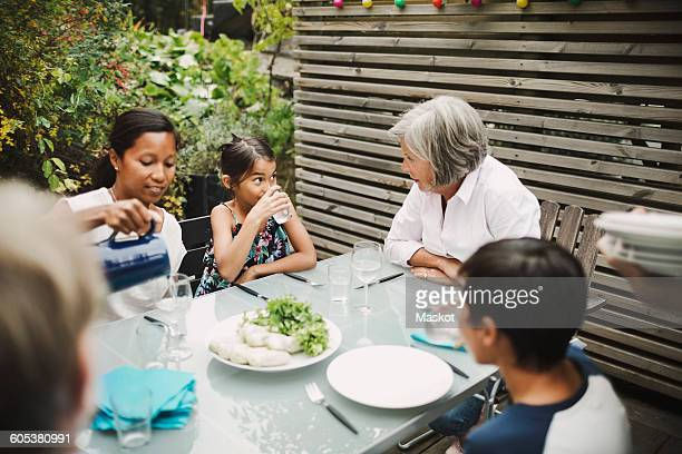 Family having meal at outdoor dining table