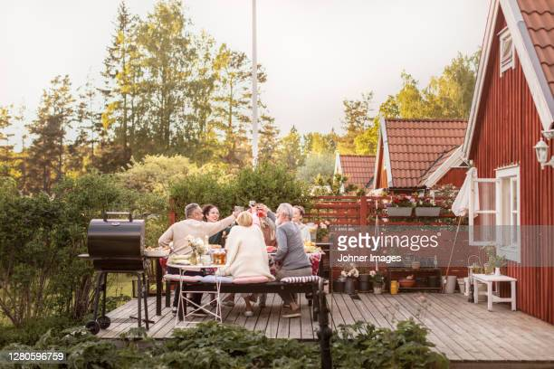 family having meal in garden - sweden stock pictures, royalty-free photos & images
