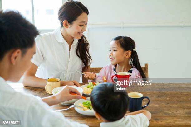 Family having meals at table