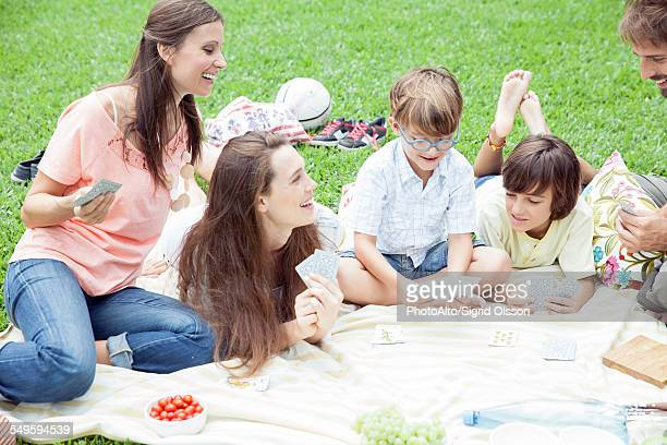 Family having picnic and playing card game