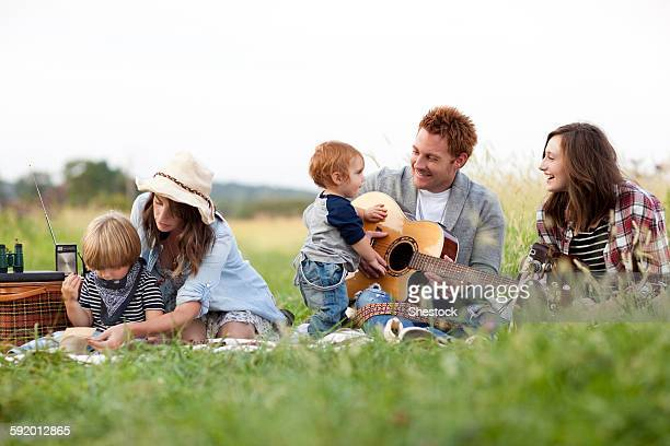 Family having picnic in rural field