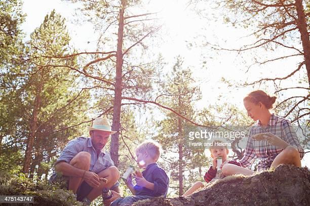 Family having picnic sitting on rocks