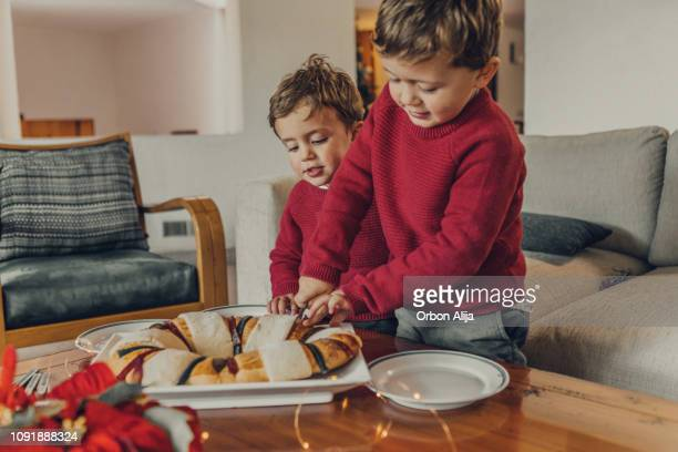 family having rosca de reyes - mexican christmas stock photos and pictures