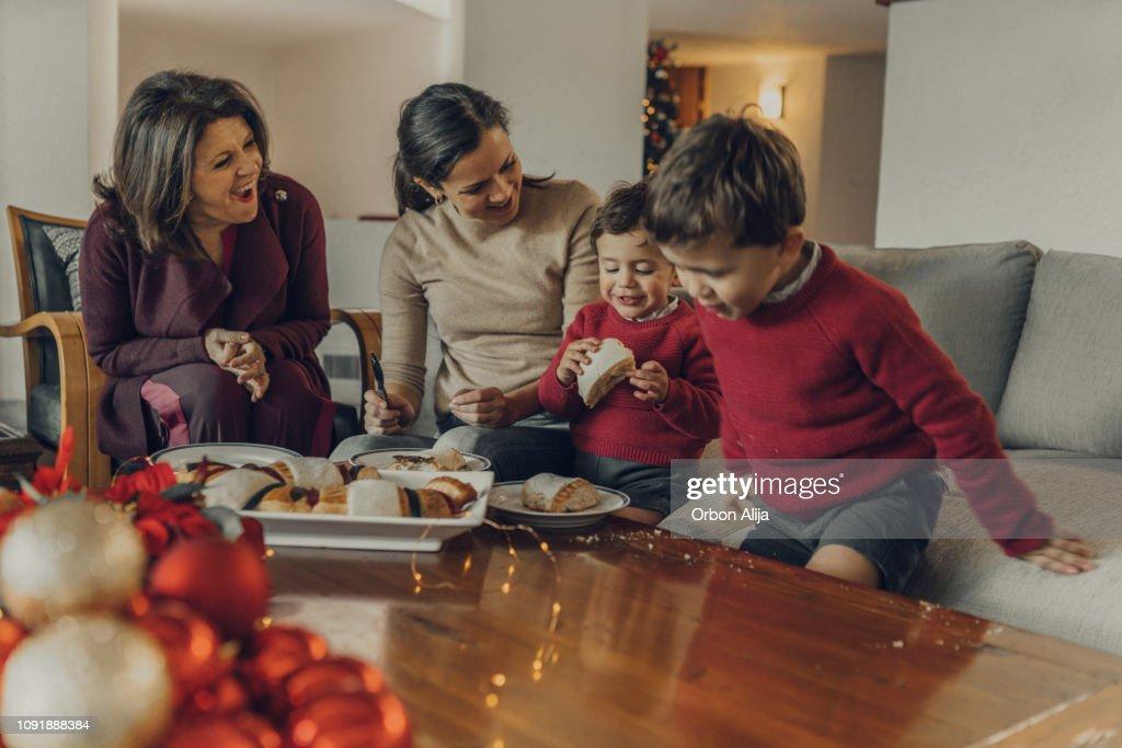 Family having Rosca de Reyes : Stock Photo