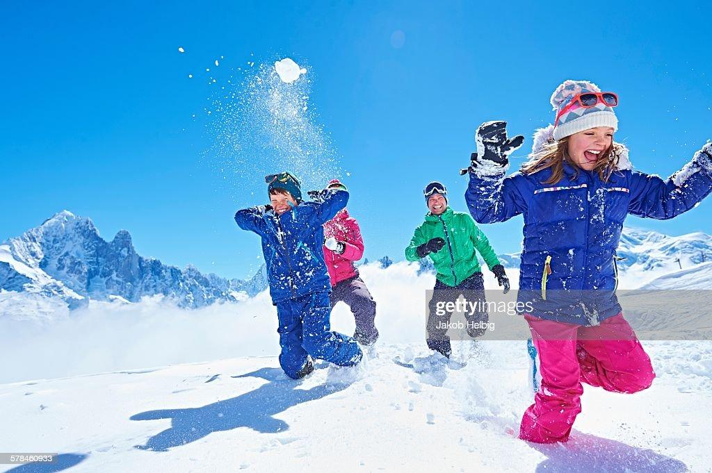 Family having snowball fight, Chamonix, France : Foto de stock