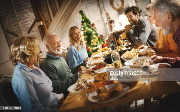 family having thanksgiving dinner. - banquet stock pictures, royalty-free photos & images