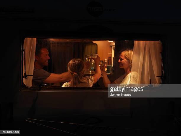 Family having toast in caravan