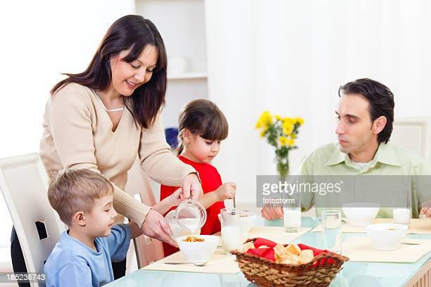 Family heaving cereals for breakfast