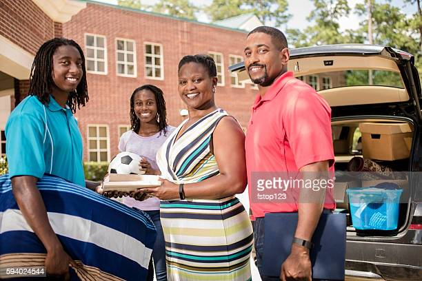 Family helps African-descent boy move into college.