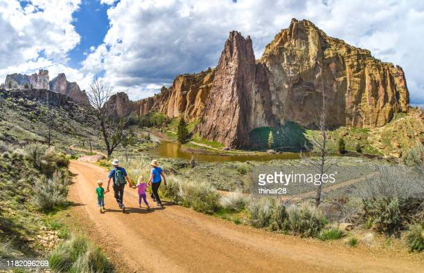 family hike at smith rock state park - oregon us state stock pictures, royalty-free photos & images