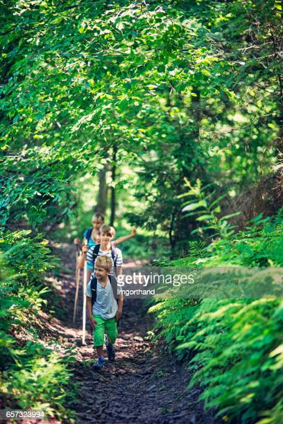 Family hiking in a green forest
