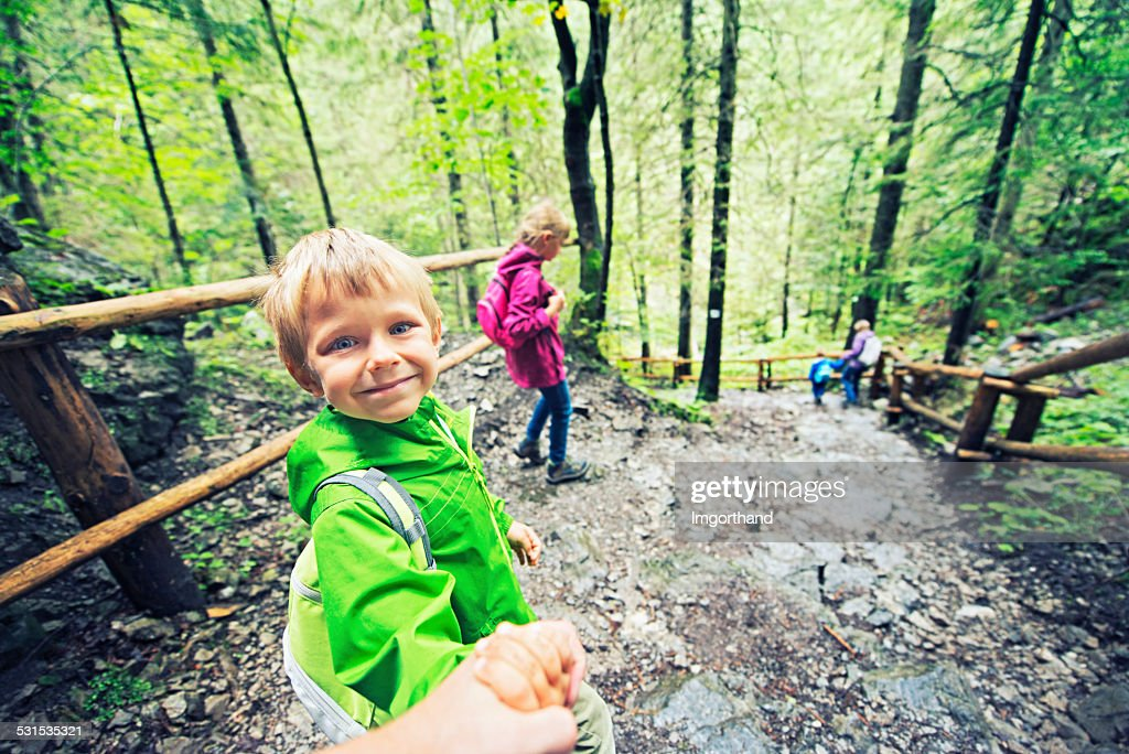 Family hiking in forest : Stock Photo